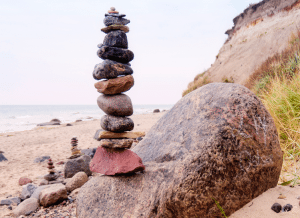 Image of precariously stacked rocks to illustrate the fragility of application stability